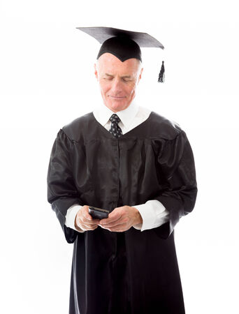 Senior male graduate text messaging on a mobile phone photo