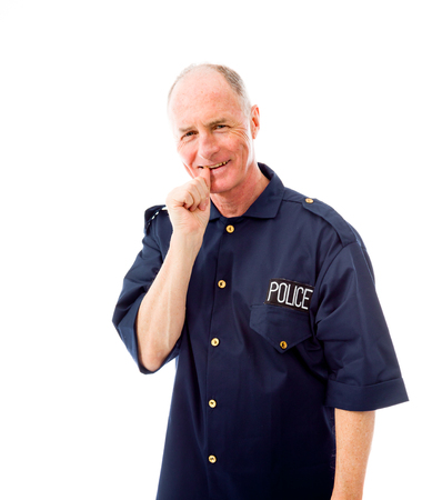 Policeman smiling with finger in mouth photo