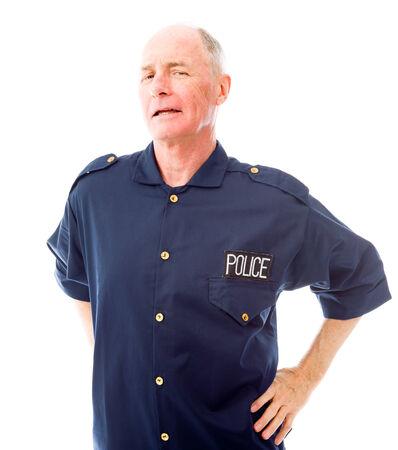 arms akimbo: Policeman standing with his arms akimbo