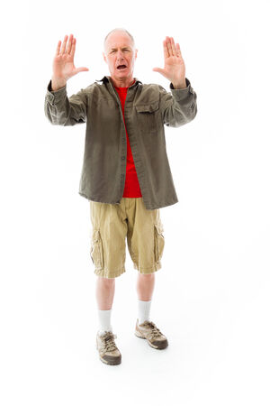 fully unbuttoned: Senior man stopping with hand gesture Stock Photo