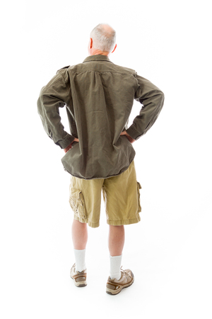 arms akimbo: Rear view of a senior man standing with his arms akimbo