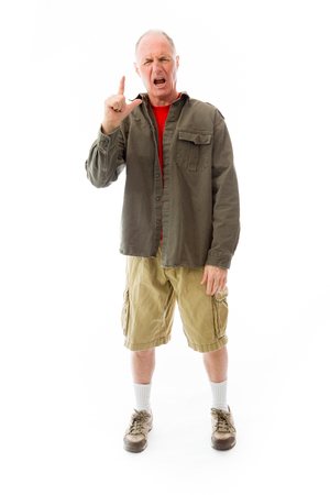 man pointing up: Frustrated senior man pointing up Stock Photo