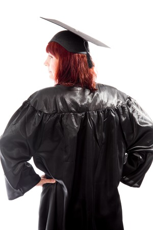arms akimbo: Rear view of a mature student standing with her arms akimbo