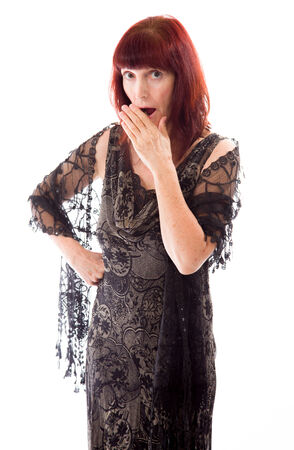 Mature woman with hand over her mouth and shock photo
