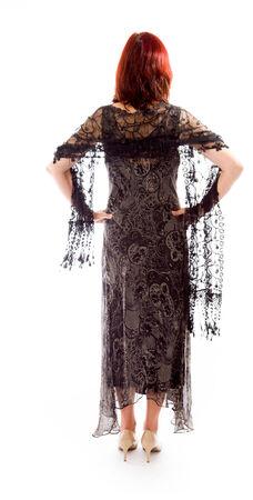 mani sui fianchi: Vista posteriore di una donna matura in piedi con le braccia sui fianchi