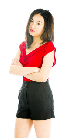 Young woman standing with her arms crossed and looking sad