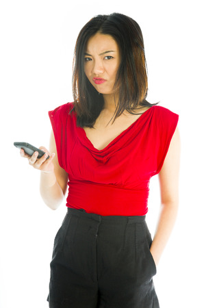 Young woman text messaging on mobile phone