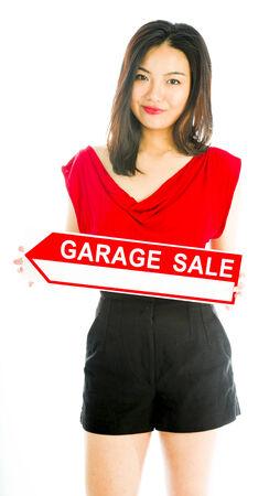 Saleswoman holding a Garage sale sign