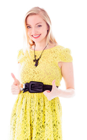 Beautiful young woman showing thumbs up sign with both hands Stock Photo - 29484196