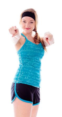 Jeune femme pointant vers la caméra avec les deux mains Banque d'images - 29487375