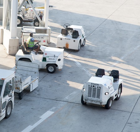 Cargo towing tractors at an airport 2011-06-15 6:51:19 AM