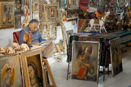 seller: Shop owner reading newspaper in a souvenir store, Peru 2011-06-19 11:43:23 AM Editorial