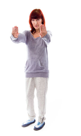Mature woman making stop gesture sign photo