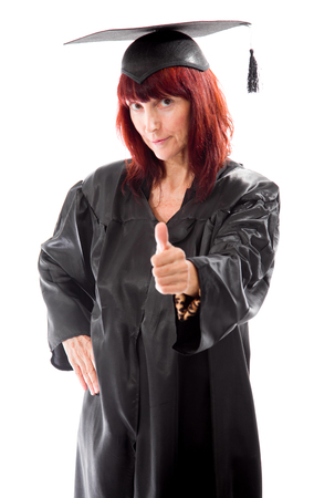 Mature student standing and showing thumbs up sign photo