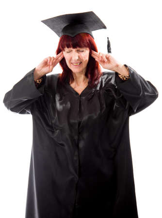 Mature student standing with fingers in her ears photo