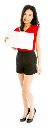 Saleswoman holding a blank placard and smiling