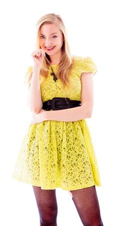 Beautiful young woman biting fingernails photo