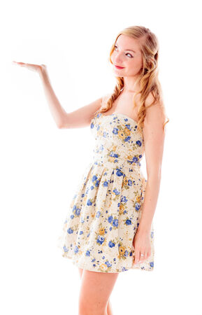 off the shoulder: Beautiful young woman standing with her arm outstretched