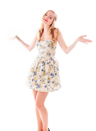 Beautiful young woman standing with her arm outstretched photo