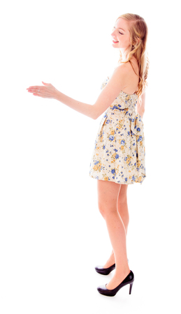 Side profile of a young woman offering hand for handshake photo