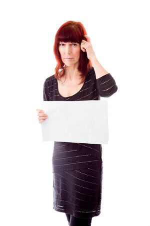 Mature woman showing a blank placard photo