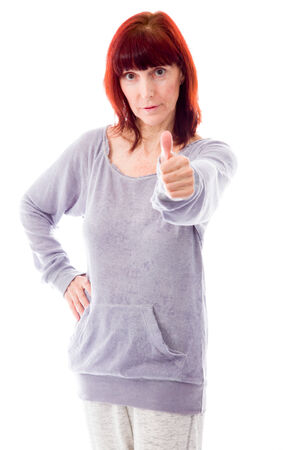 Mature woman showing thumbs up sign photo