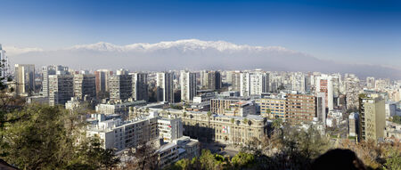 Aerial view of a city and The Andes mountain in the background, Santiago, Chile 2011-07-03 11:45:11 PM Редакционное