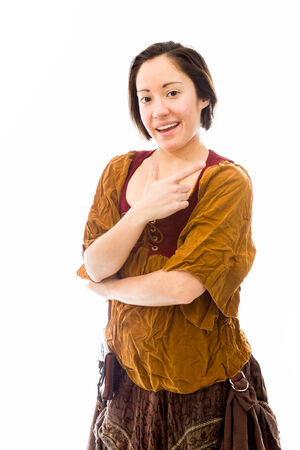 Young woman smiling and pointing photo