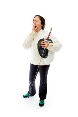 fencer: Female fencer yawning