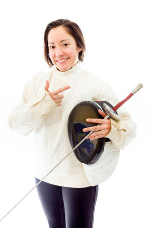 quarter foil: Female fencer holding a mask and sword with gesturing Stock Photo