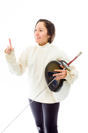 quarter foil: Female fencer holding a mask and sword with pointing upward Stock Photo