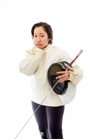 quarter foil: Female fencer looking sad with a holding mask and sword