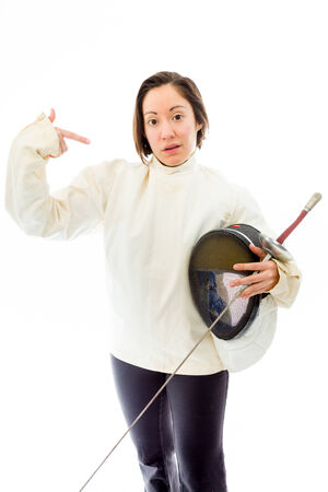quarter foil: Female fencer pointing with holding a mask and sword