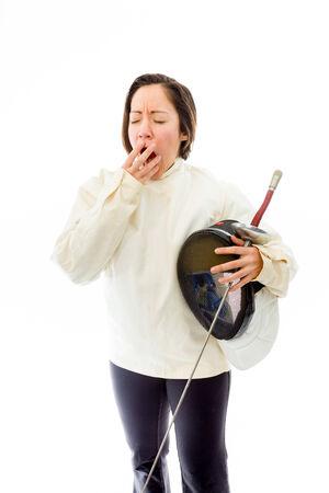 quarter foil: Female fencer yawning