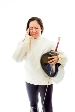esgrimista: Esgrimista Mujer que sufre de dolor de cabeza Foto de archivo