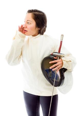 Female fencer whispering Stock Photo
