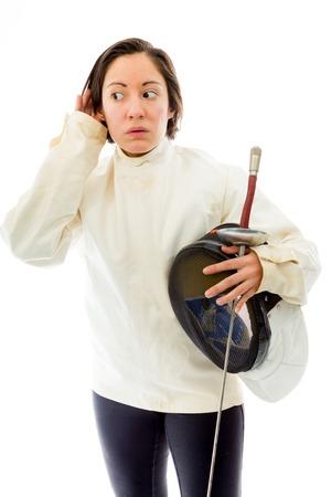 quarter foil: Female fencer trying to listen