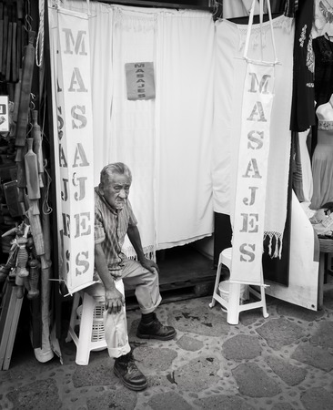 Old massager sitting outside his massage parlour, Mexico City, Mexico 2013-06-08 4:35:58 PM