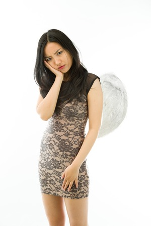 Attractive Asian young adult woman in angels and demon
