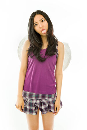 careless: Attractive Asian young adult woman in angels and demon