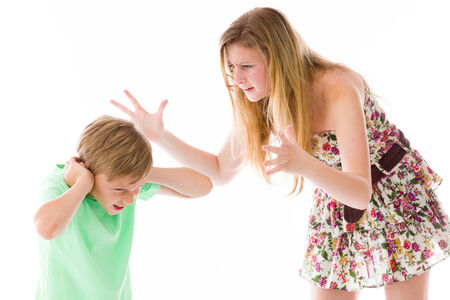 nagging: caucasian brother and siter teenager isolated on white background