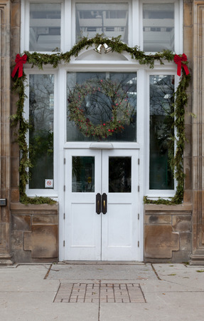 home decorated: Entrance of front door of a residential home decorated with a Christmas wreath
