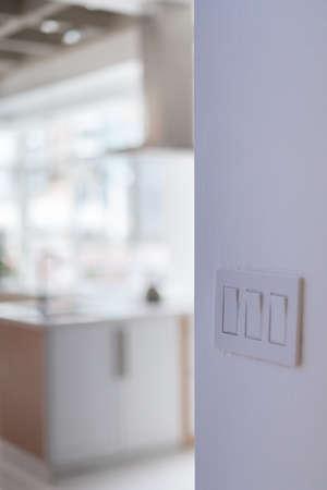 wall mounted: Close-up of white wall mounted light switch