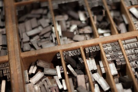 letterpress letters: Close-up of metal letterpress letters in printing machine
