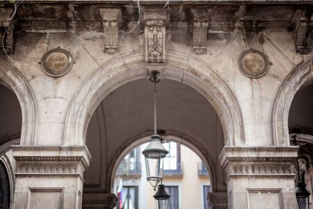 Lantern hanging at an arch of a building, Barcelona, Catalonia, Spain