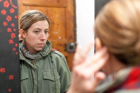 Mid adult woman admiring herself in mirror, Barcelona, Catalonia, Spain 版權商用圖片