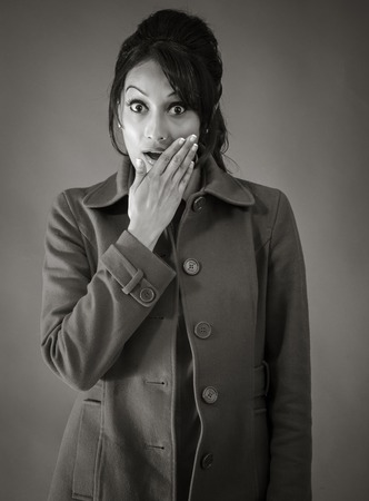 Adult indian woman in studio isolated on grey background, black and white image photo