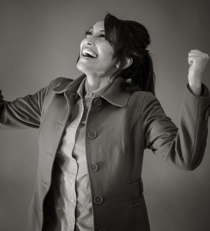 Adult indian woman in studio isolated on grey background, black and white image Stok Fotoğraf