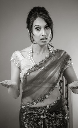 Adult indian woman in studio isolated on grey background, black and white image Banque d'images