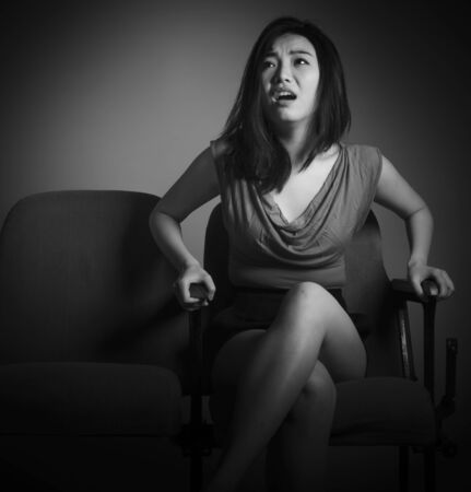 20s: Attractive Asian girl in her 20s at the theatre isolate on a white background, black and white image